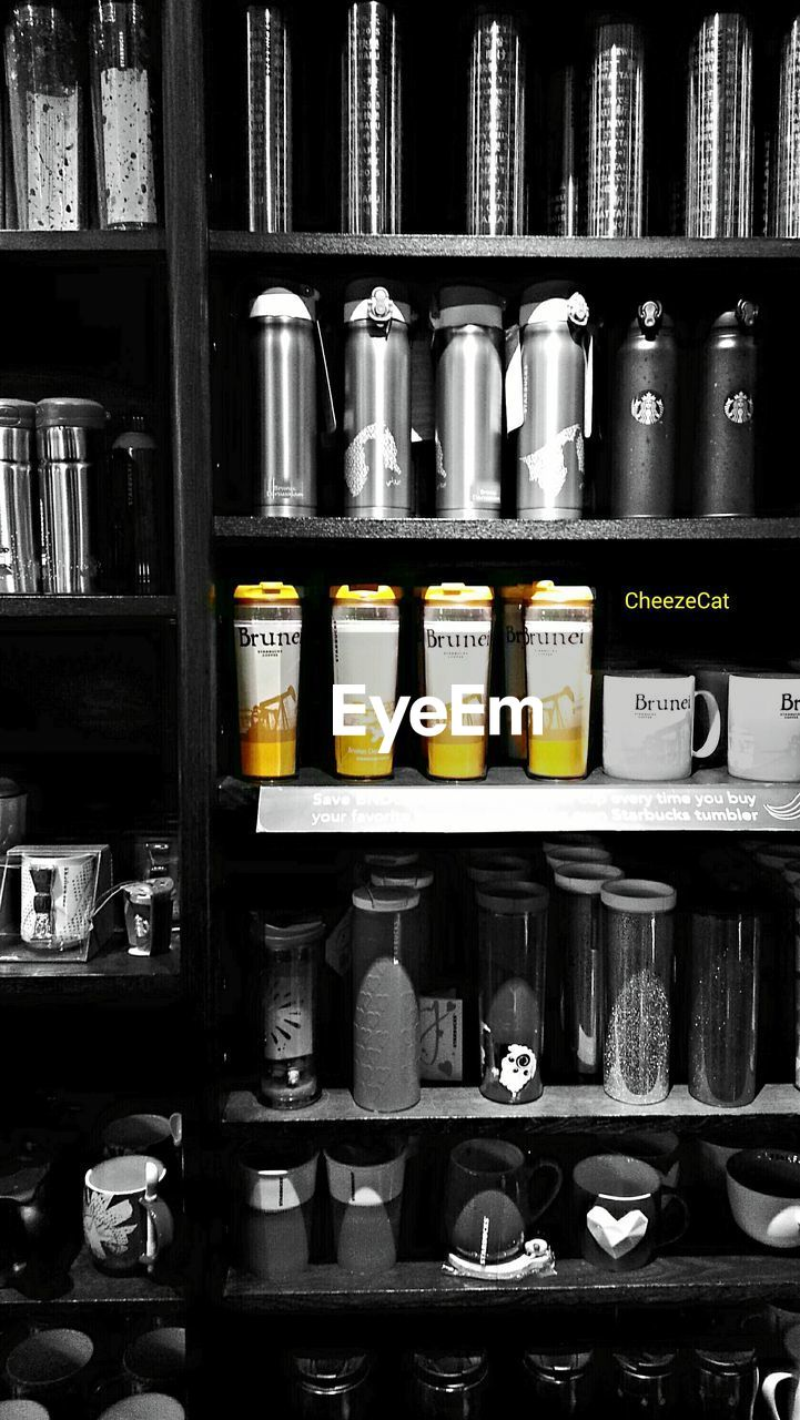 shelf, in a row, shelves, large group of objects, arrangement, text, variation, communication, no people, choice, for sale, store, retail, indoors, stack, day, factory, close-up