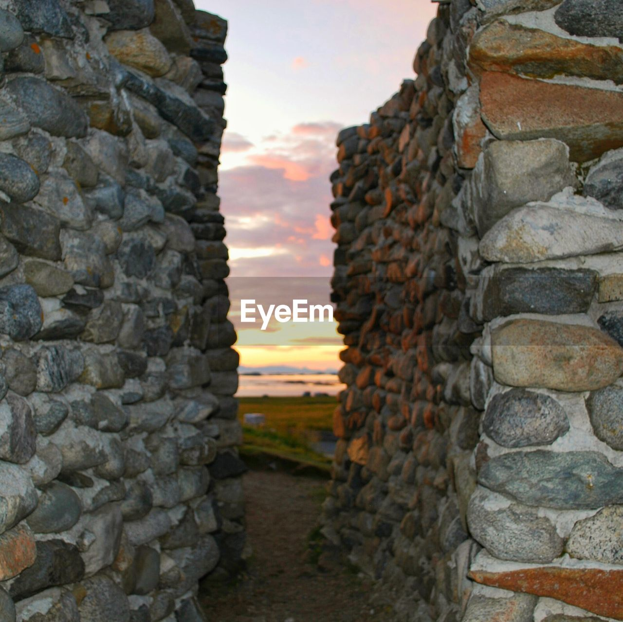 stone wall, built structure, architecture, brick wall, no people, building exterior, outdoors, day, sunset, nature, sky, tiled roof, close-up