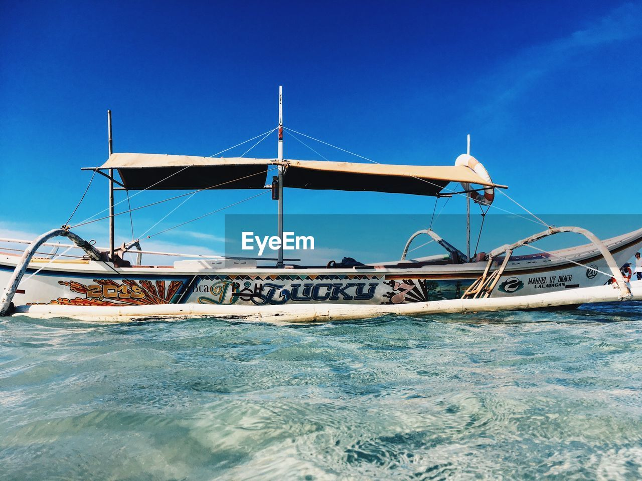 water, nautical vessel, sea, sky, transportation, mode of transportation, nature, day, waterfront, clear sky, blue, no people, travel, sunlight, beauty in nature, outdoors, sailboat, moored, scenics - nature, yacht, fishing boat