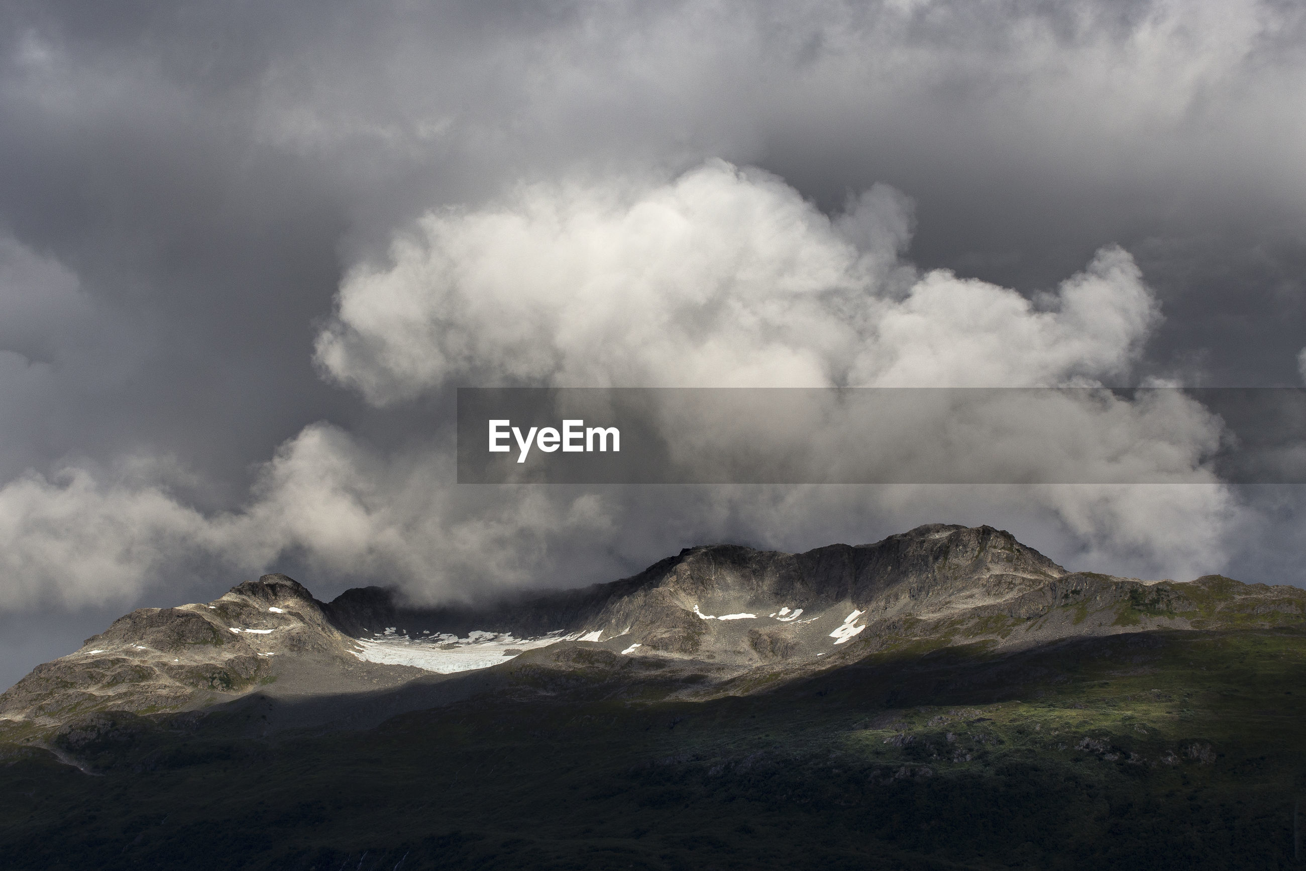 SCENIC VIEW OF SNOW COVERED MOUNTAIN AGAINST CLOUDY SKY