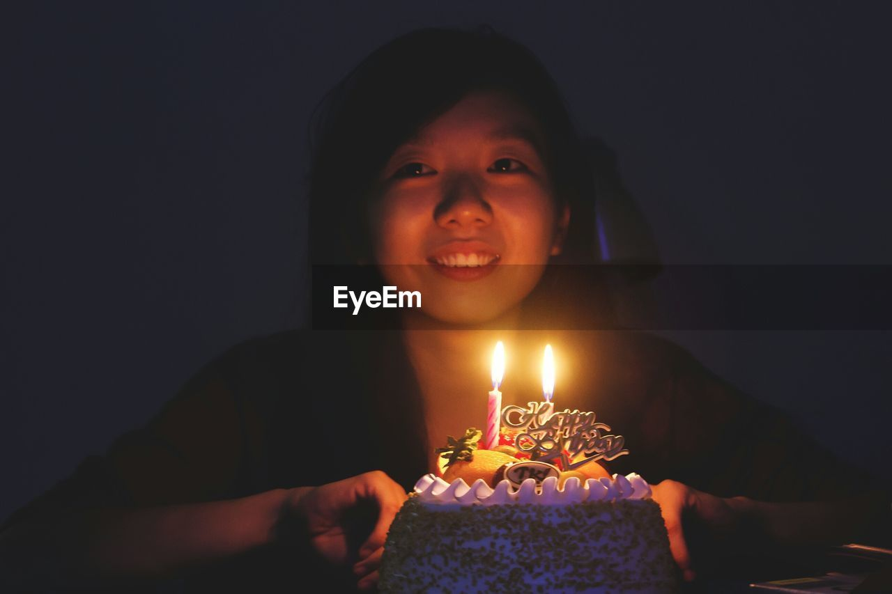 Portrait Of Young Woman With Birthday Cake
