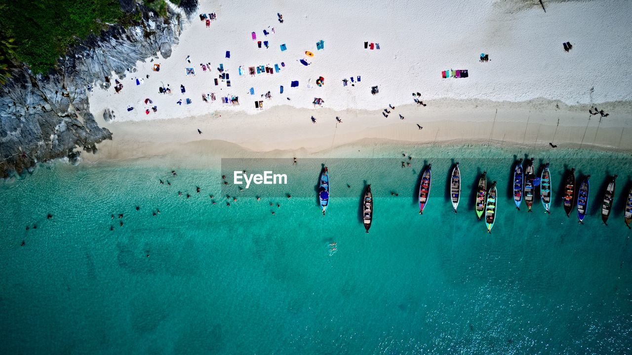 Aerial View Of Boats And Crowd At Beach