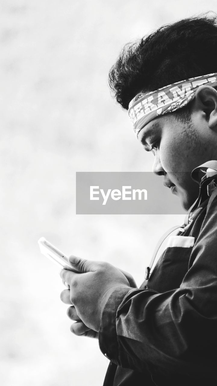 Portrait of boy holding smart phone