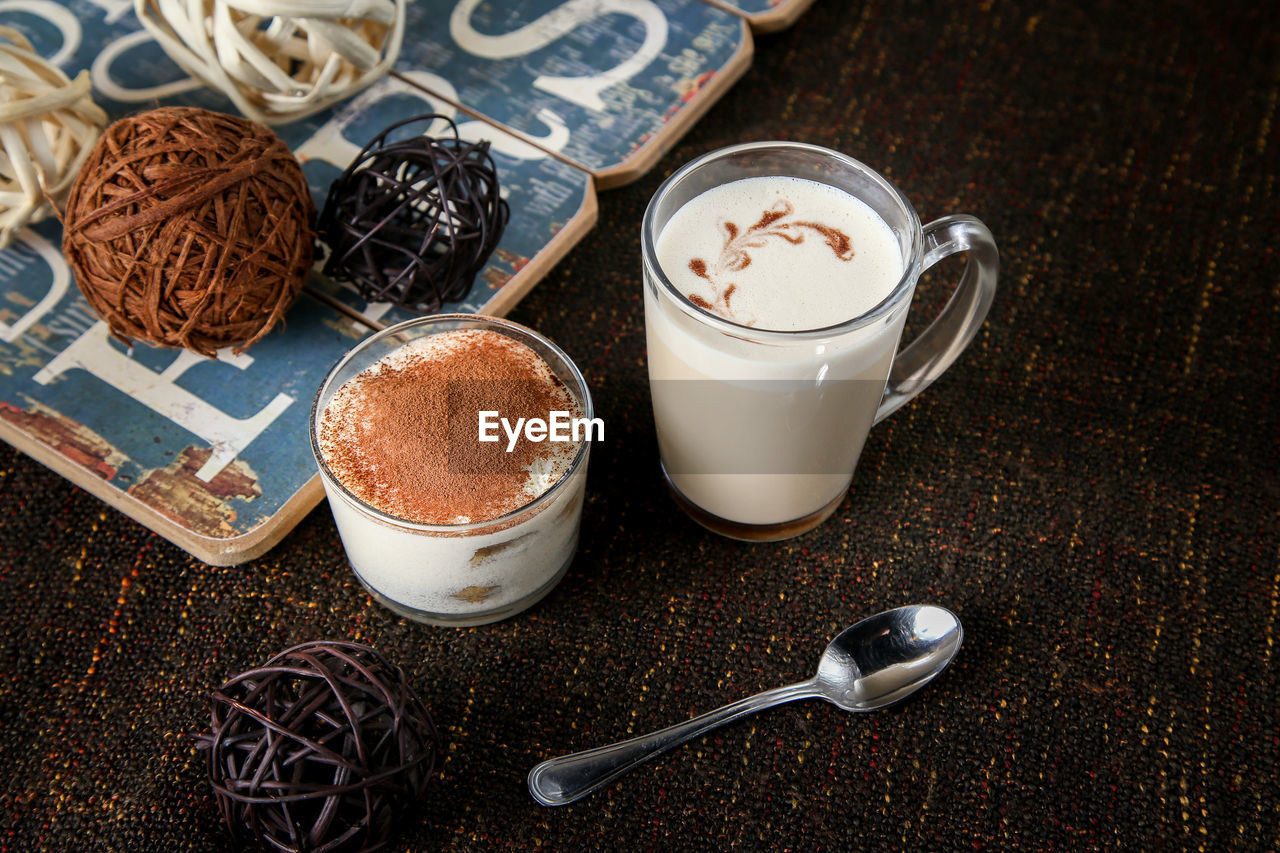 food and drink, drink, refreshment, spoon, coffee, eating utensil, coffee - drink, cup, mug, kitchen utensil, coffee cup, food, still life, table, sweet food, freshness, indoors, crockery, indulgence, hot drink, frothy drink, teaspoon, no people, saucer, temptation, latte