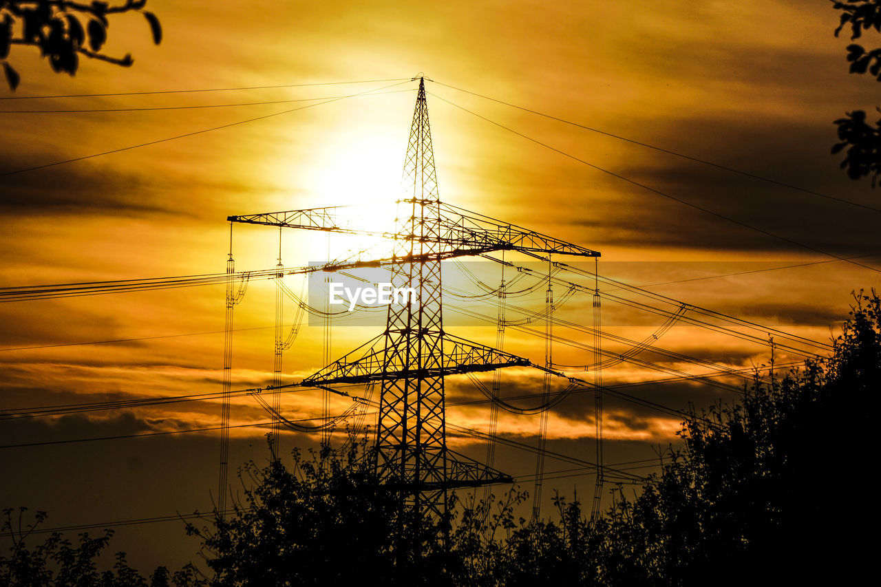 sunset, sky, cable, electricity, power line, power supply, electricity pylon, fuel and power generation, cloud - sky, silhouette, technology, nature, low angle view, connection, no people, tree, plant, orange color, complexity, outdoors, iron - metal, electrical equipment
