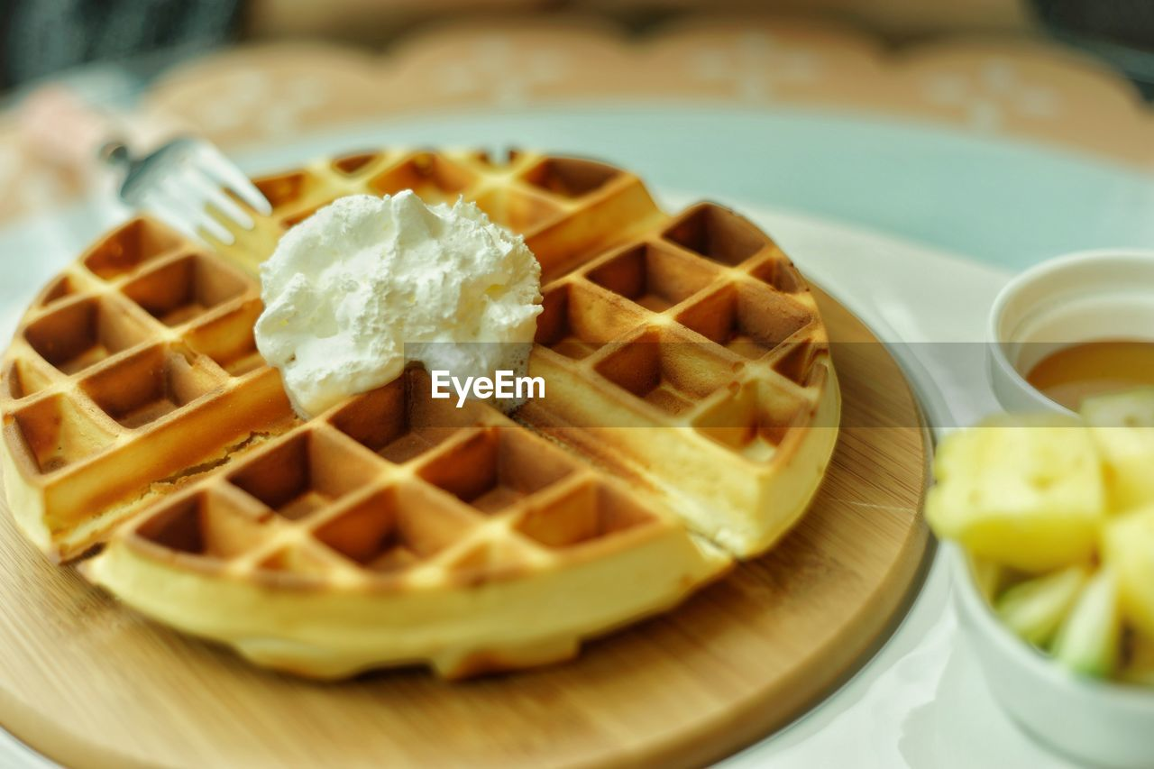 food, food and drink, ready-to-eat, freshness, still life, indulgence, plate, sweet food, close-up, table, no people, dessert, indoors, unhealthy eating, sweet, temptation, waffle, serving size, high angle view, selective focus, snack, breakfast