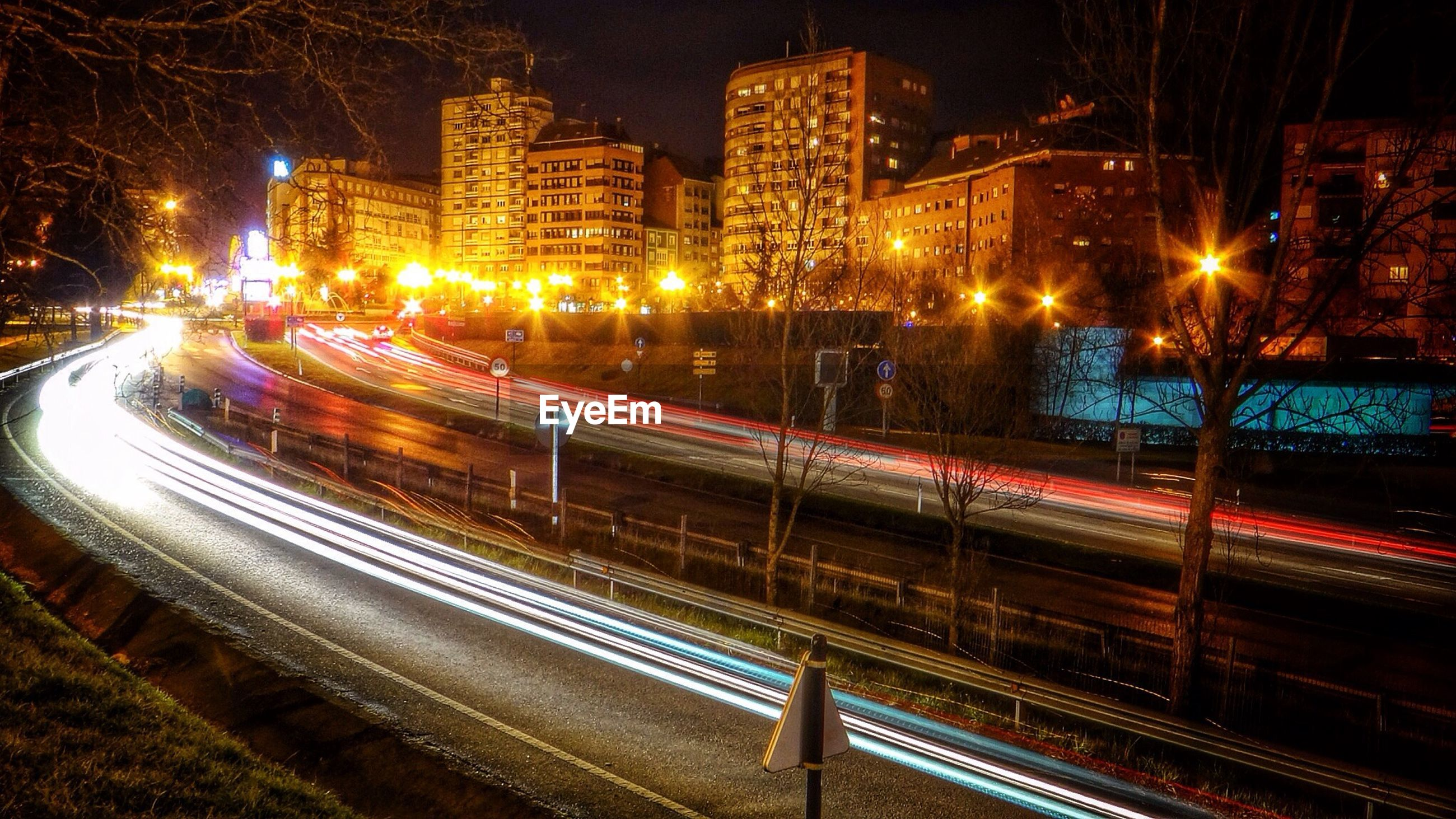 illuminated, night, light trail, transportation, long exposure, city, speed, motion, street light, building exterior, road, street, traffic, high angle view, blurred motion, architecture, built structure, city life, on the move, city street