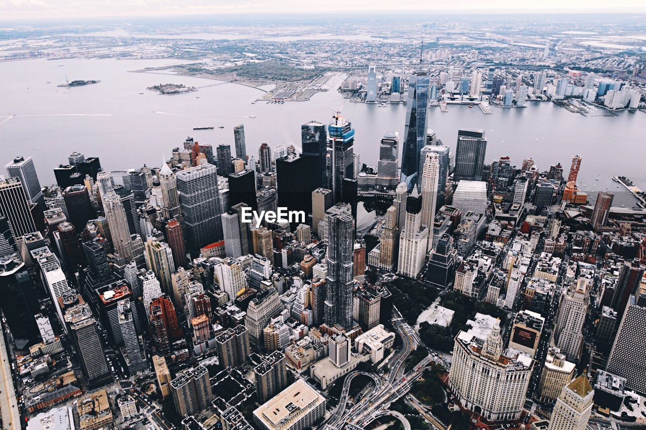 High angle view of one world trade center in city by river