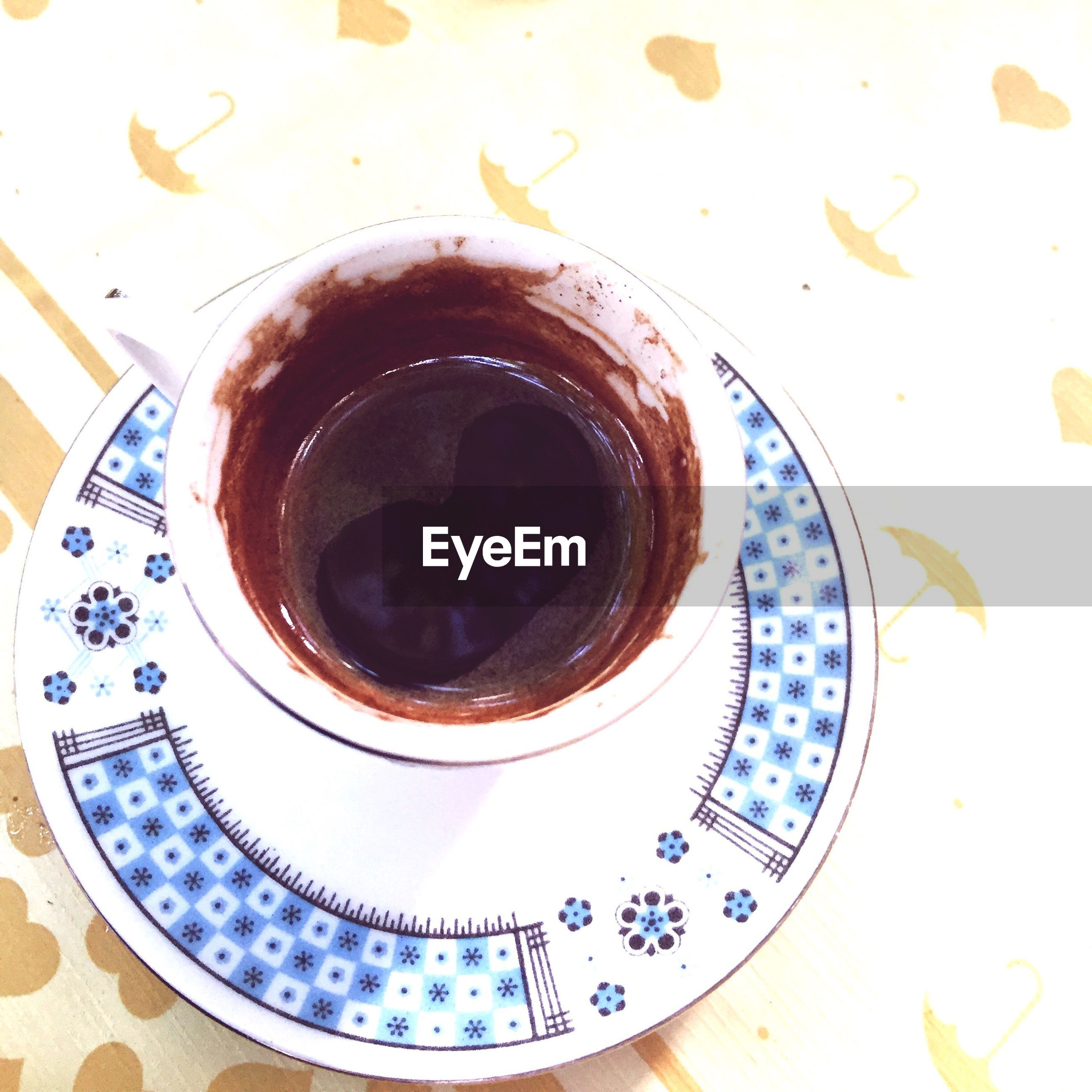 coffee cup, refreshment, freshness, coffee - drink, saucer, cup, still life, directly above, coffee, spoon, close-up, frothy drink, indulgence, overhead view, breakfast, black coffee, beverage, ready-to-eat, serving size, tea cup, no people, froth art