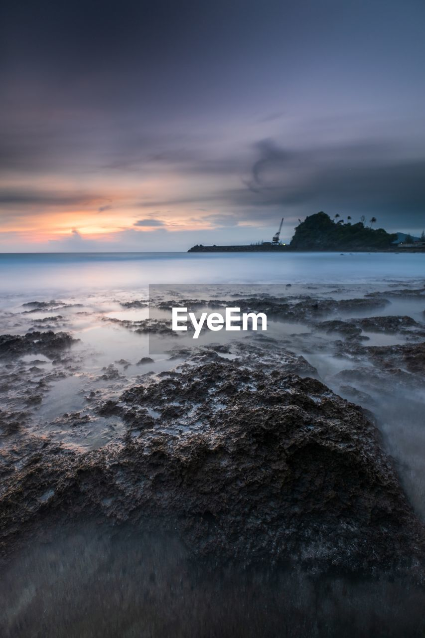 sky, sea, water, beauty in nature, scenics - nature, cloud - sky, sunset, beach, land, horizon over water, horizon, tranquility, nature, tranquil scene, motion, rock, no people, solid, rock - object, outdoors, power in nature