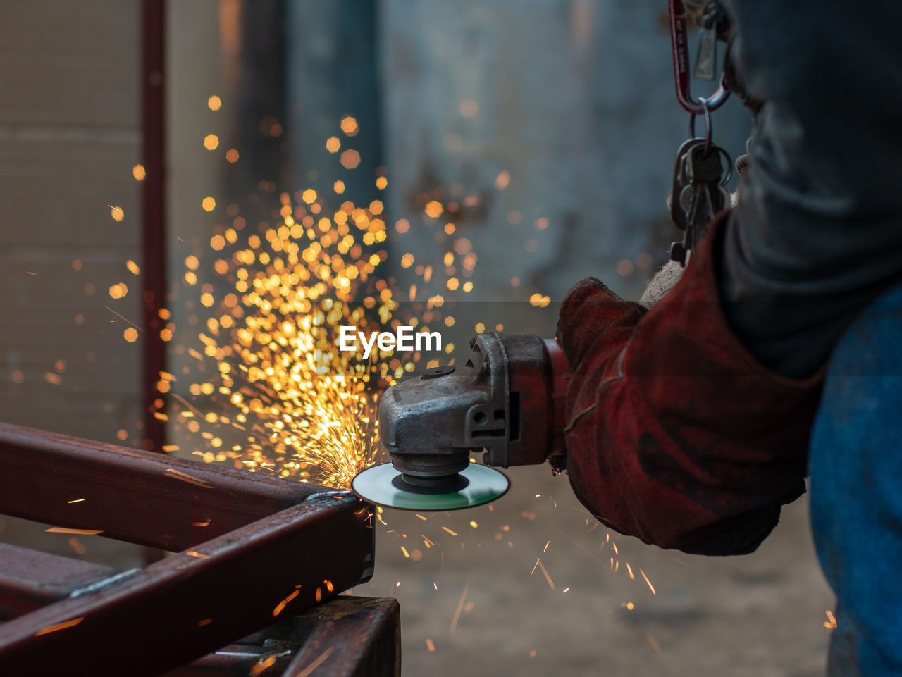Cropped Image Of Worker Using Machinery On Metal At Workshop