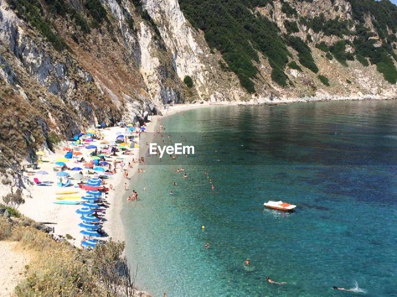 high angle view, water, nature, day, beauty in nature, scenics, outdoors, mountain, large group of people, sea, tree, sky, people