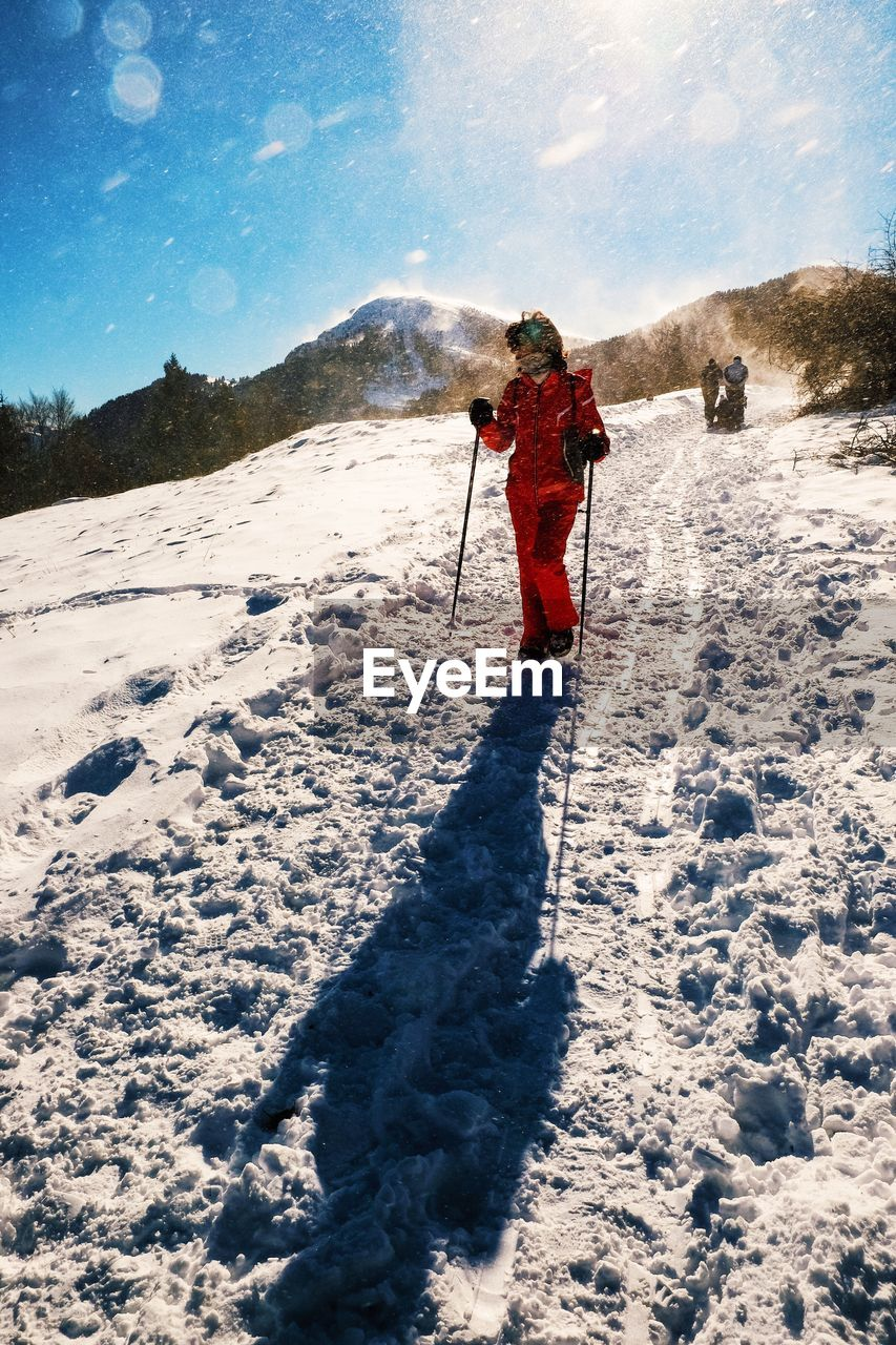 snow, cold temperature, winter, full length, one person, adventure, leisure activity, rear view, nature, real people, day, holding, walking, standing, outdoors, sky, beauty in nature, hiking, lifestyles, mountain, men, one man only, warm clothing, adult, adults only, people