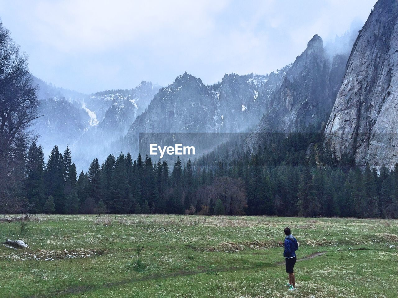 Full length of man standing on field against mountains