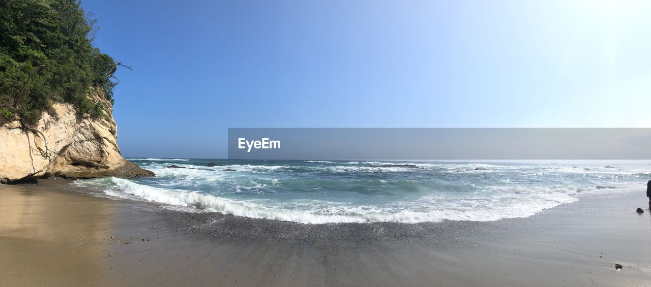 sea, water, land, beach, beauty in nature, sky, scenics - nature, motion, wave, horizon over water, horizon, nature, tranquility, aquatic sport, clear sky, sport, tranquil scene, day, surfing, outdoors, flowing water