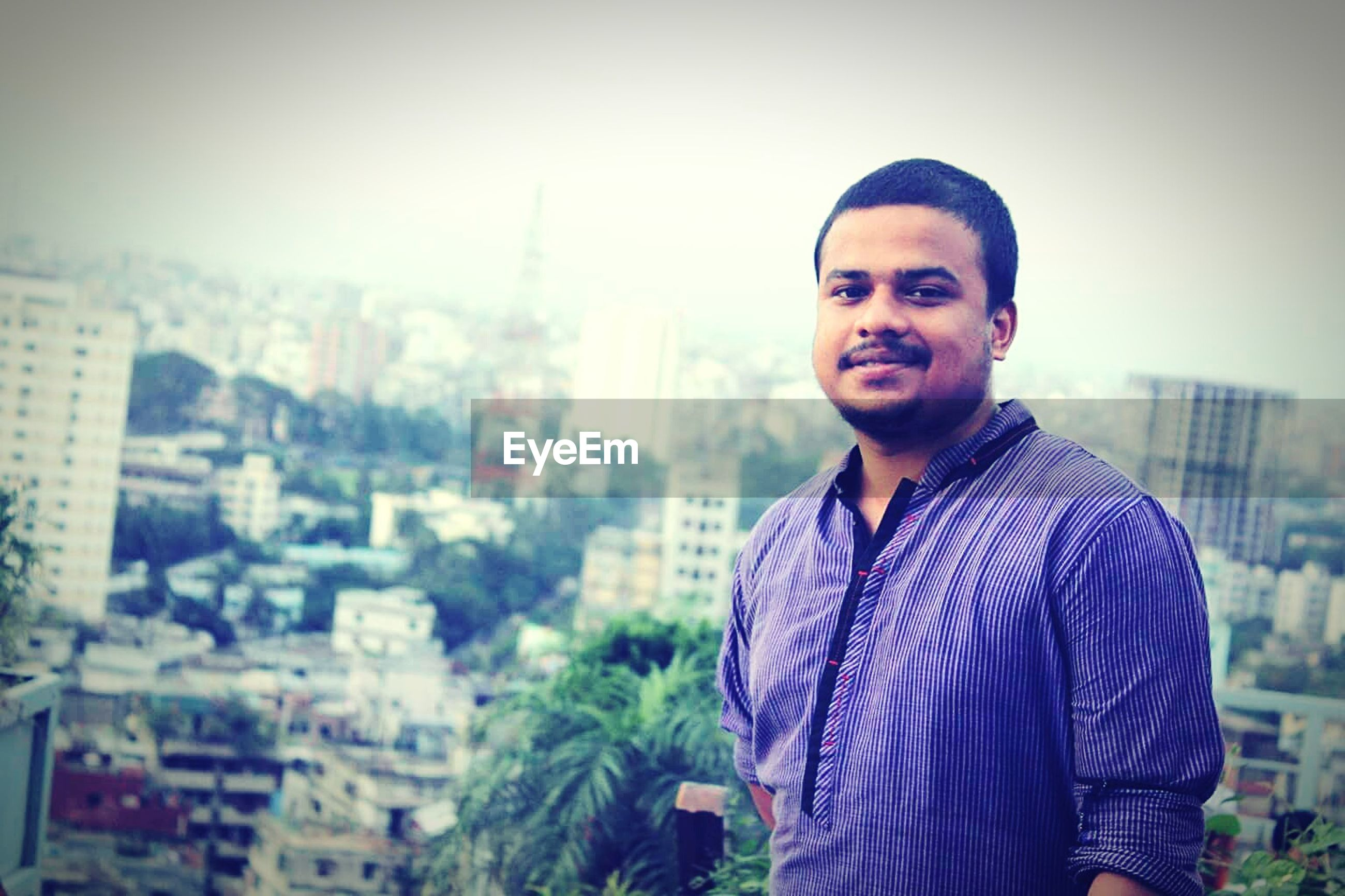 smiling, portrait, one person, city, cityscape, real people, outdoors, human, one man only, day, young adult, people, adult