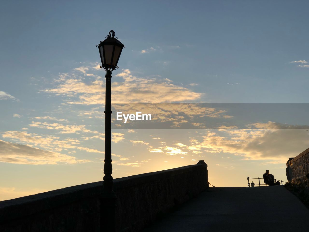street, sky, lighting equipment, sunset, street light, architecture, built structure, cloud - sky, nature, orange color, low angle view, outdoors, building exterior, silhouette, connection, beauty in nature, no people, electric light, light, scenics - nature, electric lamp