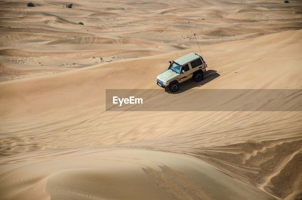 desert, sand, landscape, sand dune, arid climate, mode of transportation, land, land vehicle, climate, transportation, scenics - nature, off-road vehicle, motor vehicle, environment, car, travel, non-urban scene, nature, beauty in nature, remote, no people, outdoors