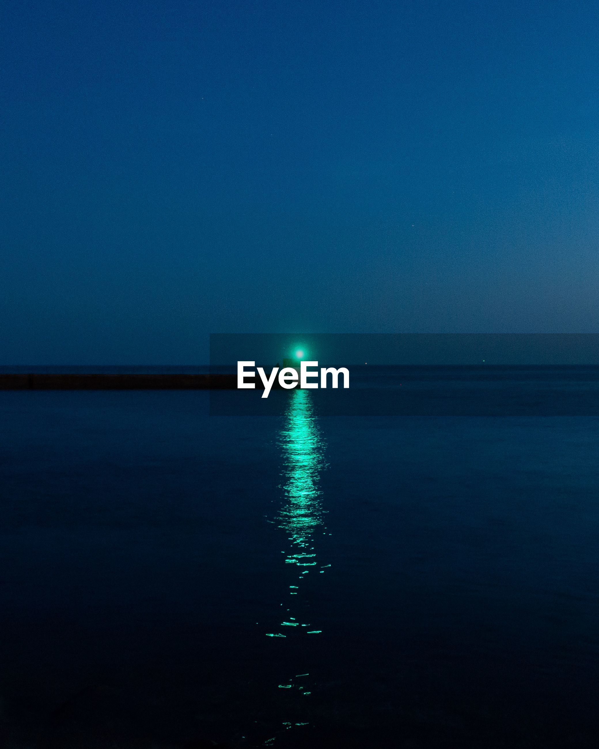 water, sea, sky, beauty in nature, scenics - nature, tranquility, waterfront, night, horizon over water, tranquil scene, nature, horizon, no people, illuminated, reflection, clear sky, copy space, blue, idyllic, moonlight