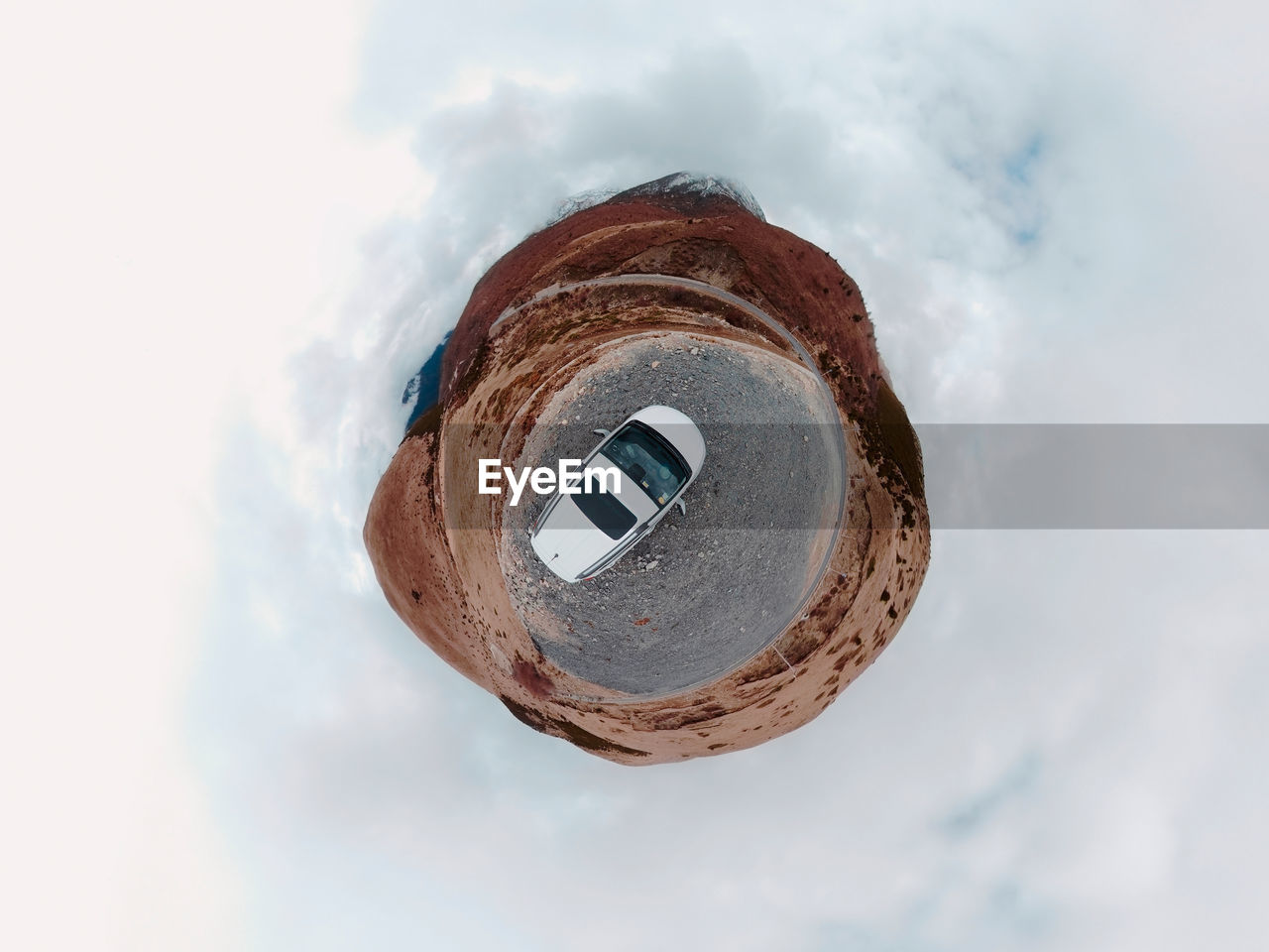 cloud - sky, sky, low angle view, circle, geometric shape, shape, day, nature, architecture, built structure, no people, outdoors, hole, building exterior, directly above, close-up, metal, brown, technology, design, digital composite, directly below, pollution
