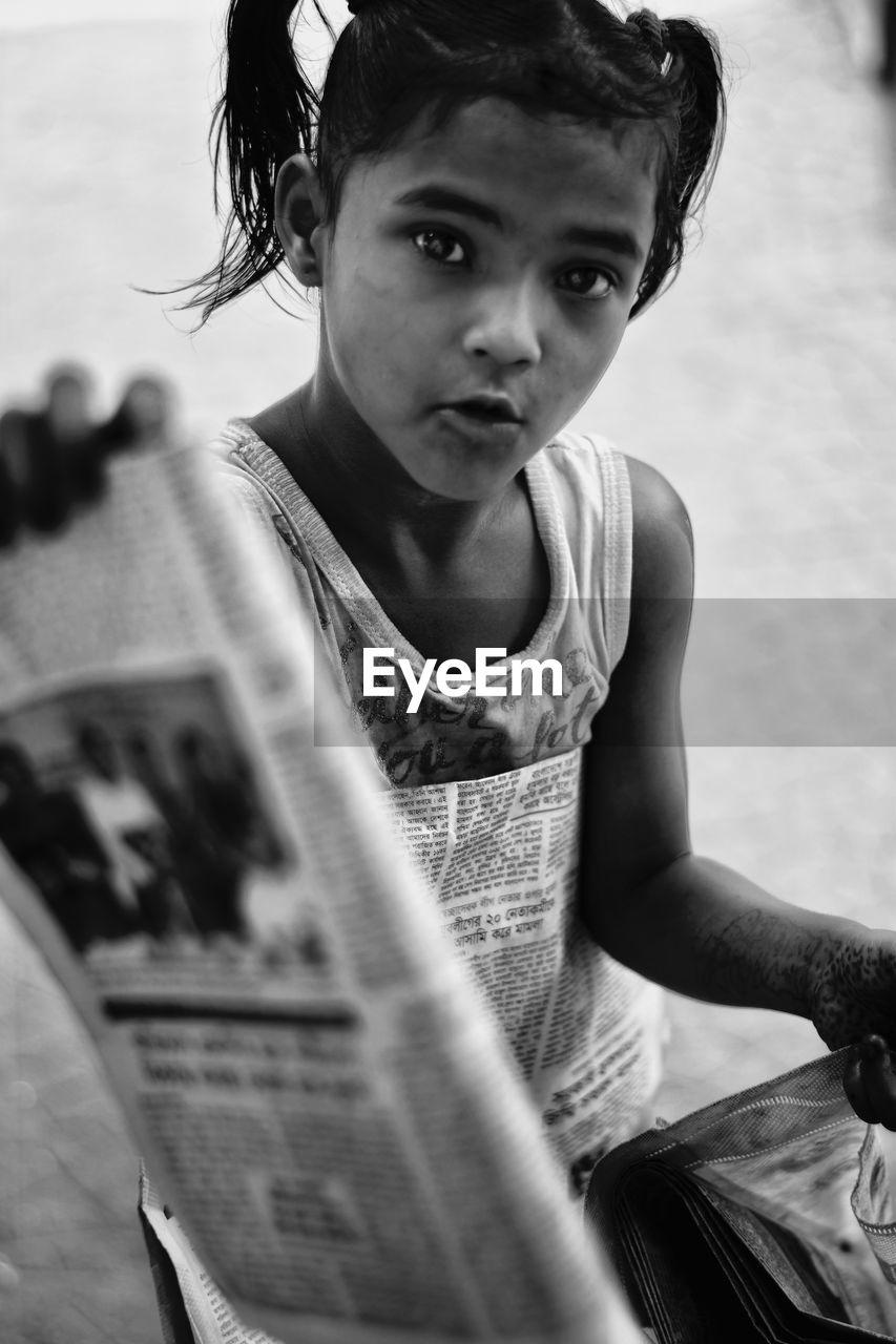 Portrait Of Girl Holding Newspaper