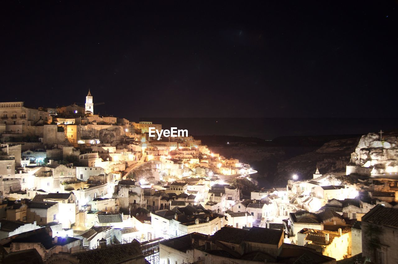 High Angle View Of Illuminated Town Against Sky At Night