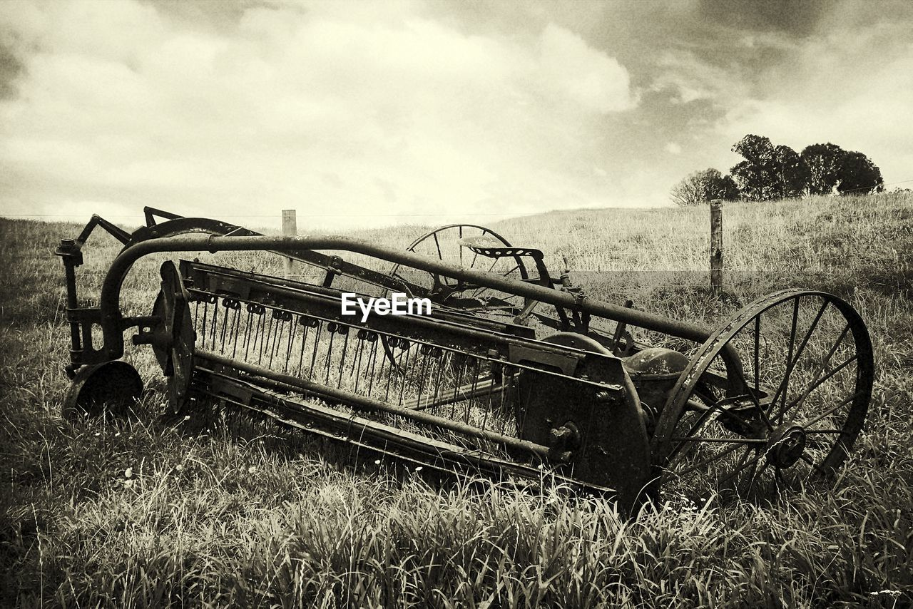 abandoned, damaged, obsolete, field, agricultural machinery, old, transportation, sky, grass, cloud - sky, run-down, day, agriculture, no people, bad condition, rural scene, growth, outdoors, nature, combine harvester, landscape, tree