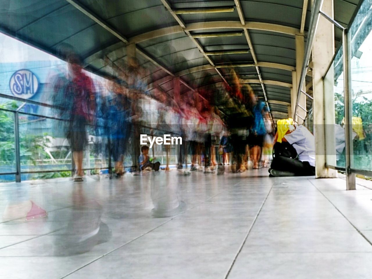 real people, blurred motion, indoors, walking, lifestyles, leisure activity, men, full length, day, women, architecture, people