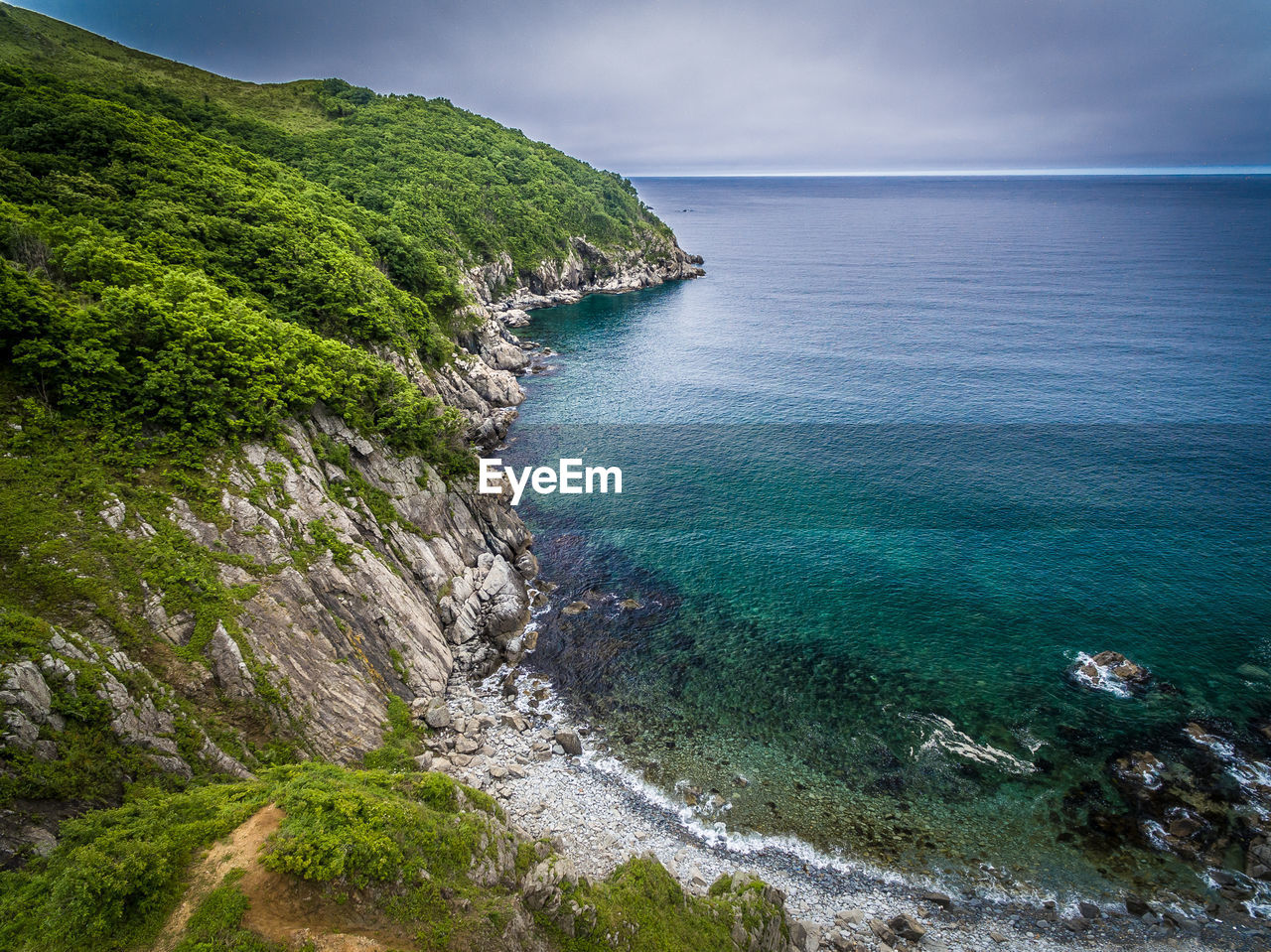 sea, nature, beauty in nature, scenics, tranquil scene, water, high angle view, tranquility, outdoors, no people, sky, day, cliff, horizon over water, mountain