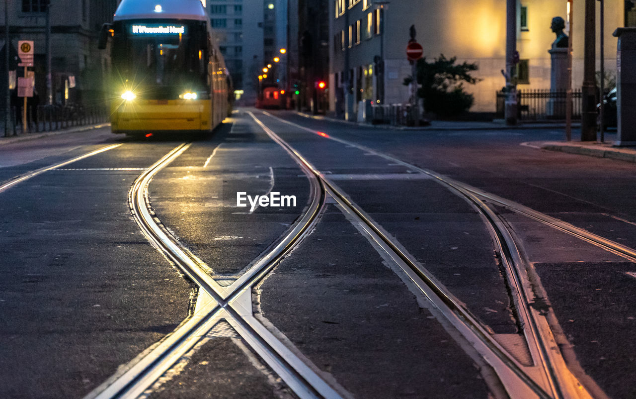 Illuminated Tramway On Railroad Track At Night