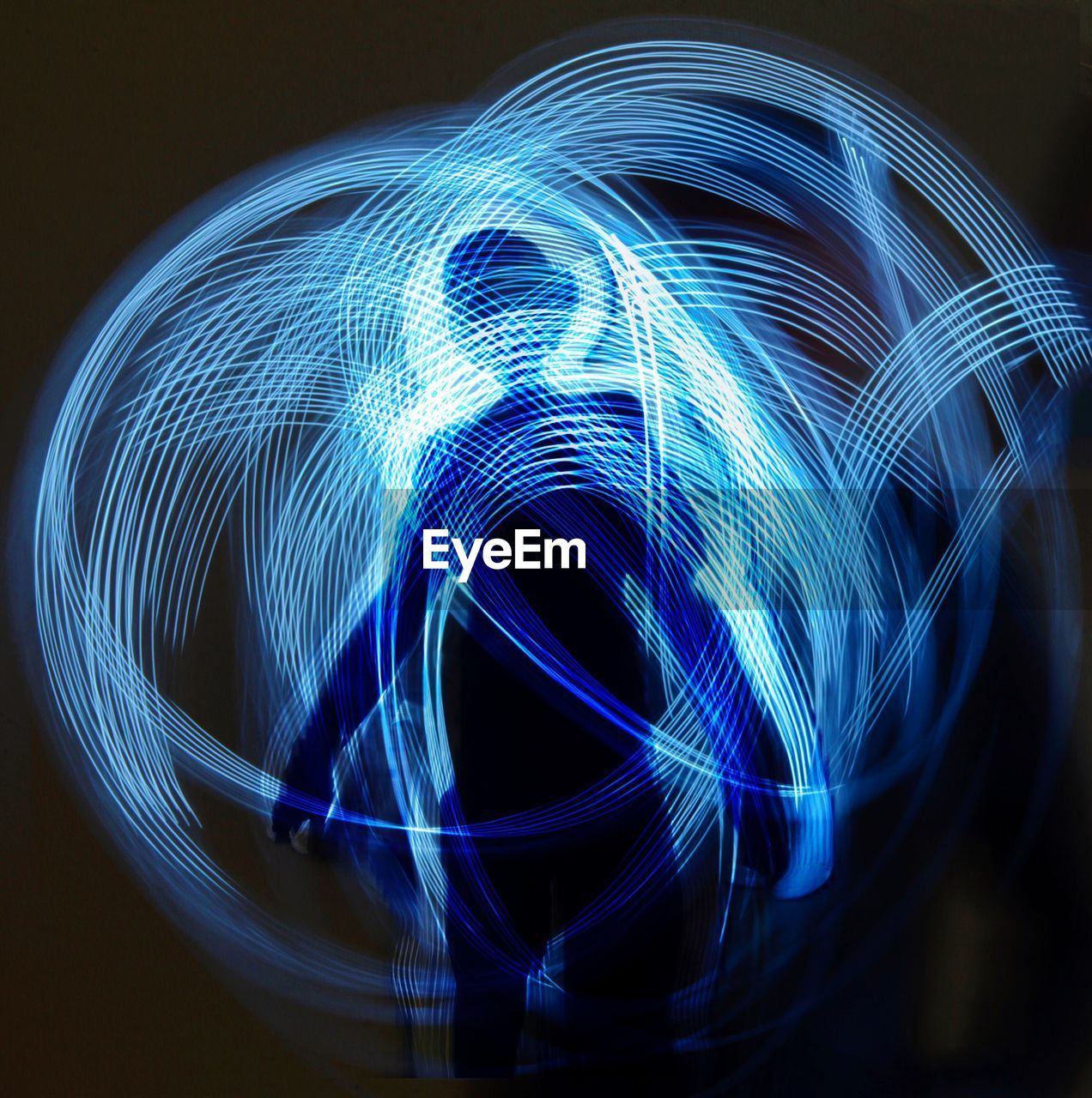 long exposure, motion, light trail, blue, pattern, light painting, illuminated, night, speed, glowing, blurred motion, creativity, art and craft, abstract, technology, light - natural phenomenon, design, no people, indoors, studio shot, black background, light, fiber optic, complexity, wire wool