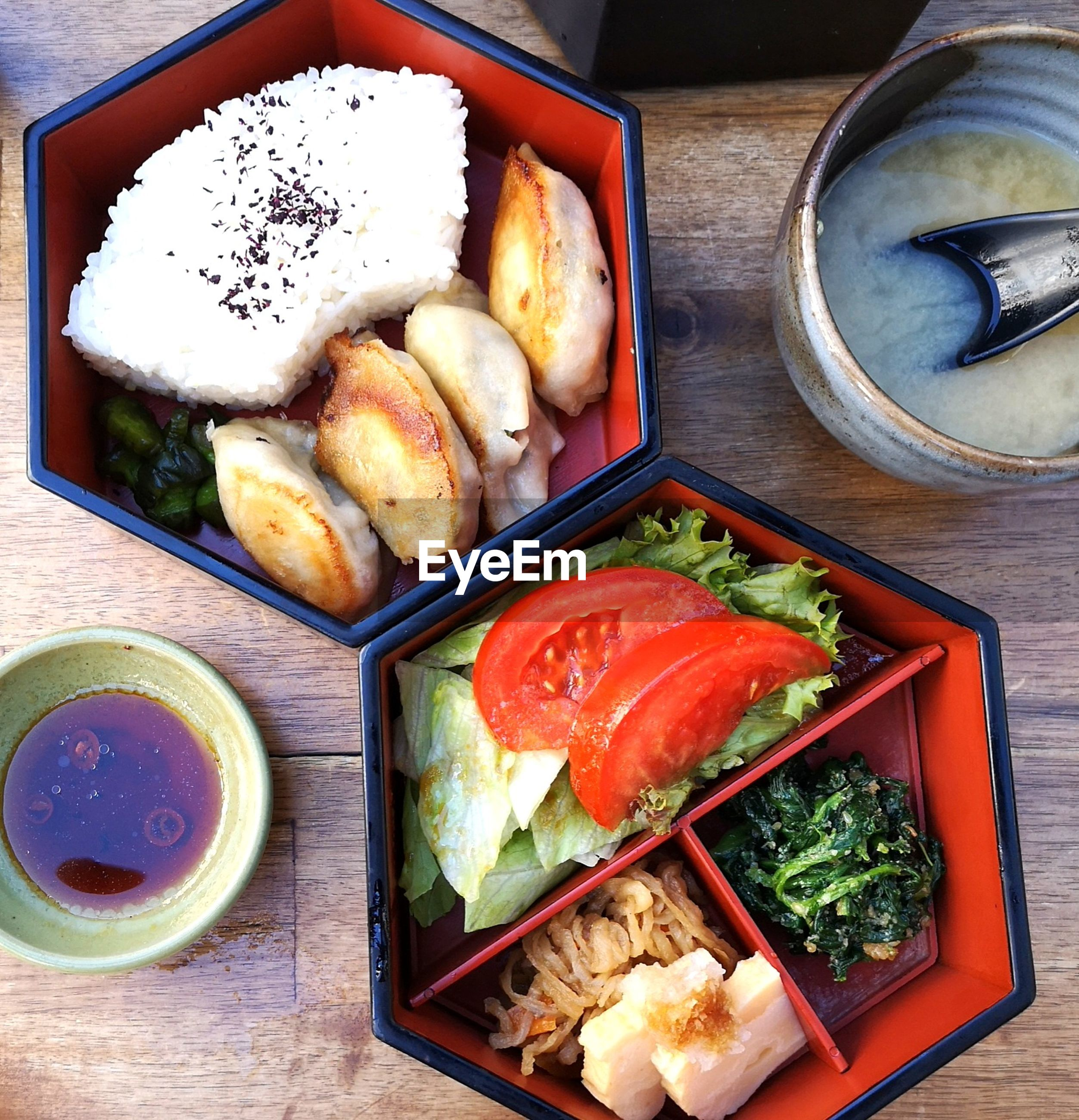 High angle view of japanese food in a bento box on table