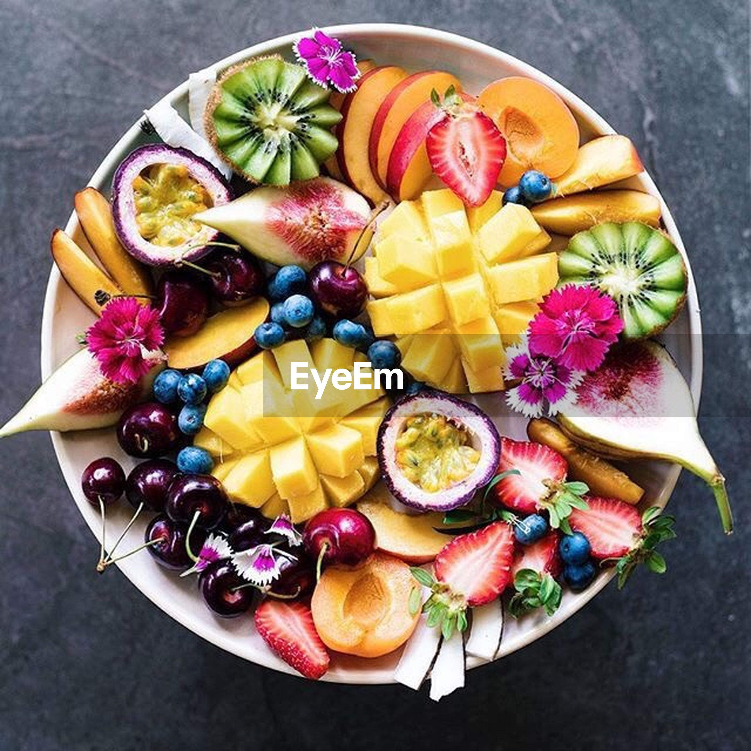 food and drink, multi colored, food, freshness, high angle view, indoors, plate, directly above, large group of objects, fruit, variation, colorful, person, abundance, choice, creativity, arrangement, ready-to-eat, indulgence