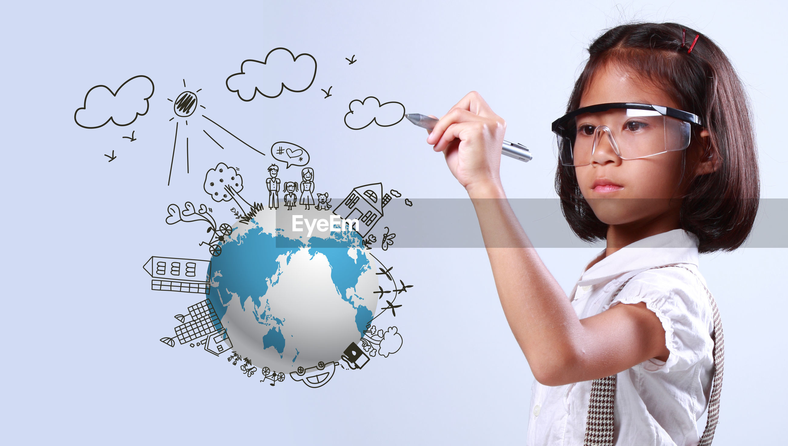 Digital composite image of girl drawing over earth against white background