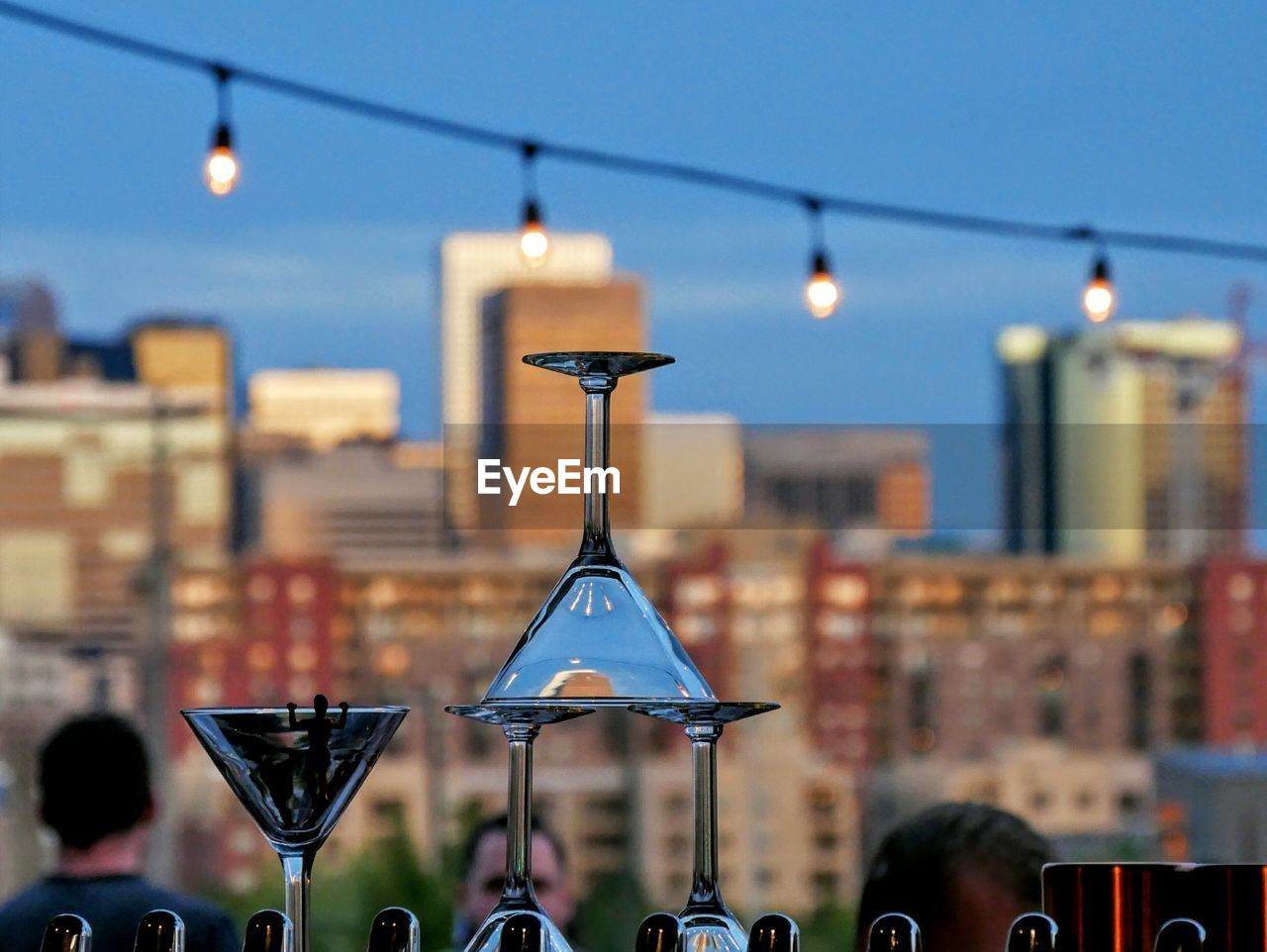 Close-Up Of Martini Glasses With City In Background
