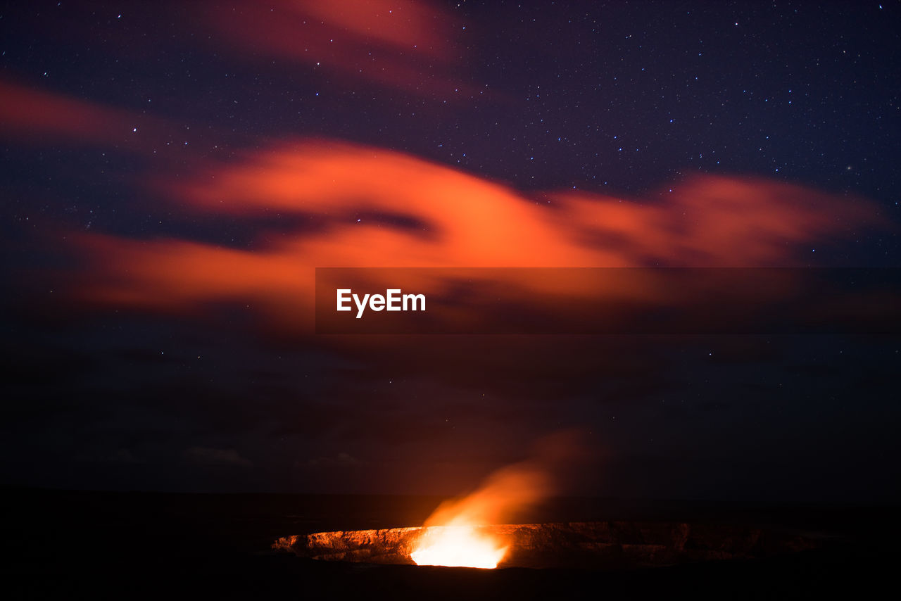night, orange color, beauty in nature, nature, sky, no people, outdoors, flame, scenics, cloud - sky, water, star - space, astronomy