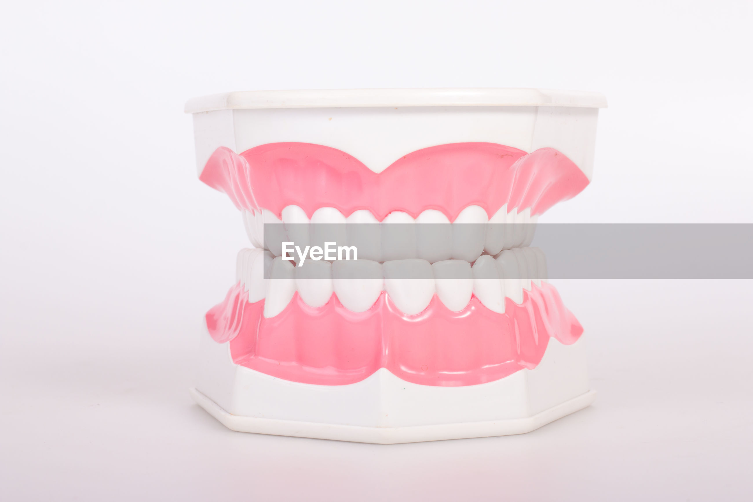 Close-up of denture on white background