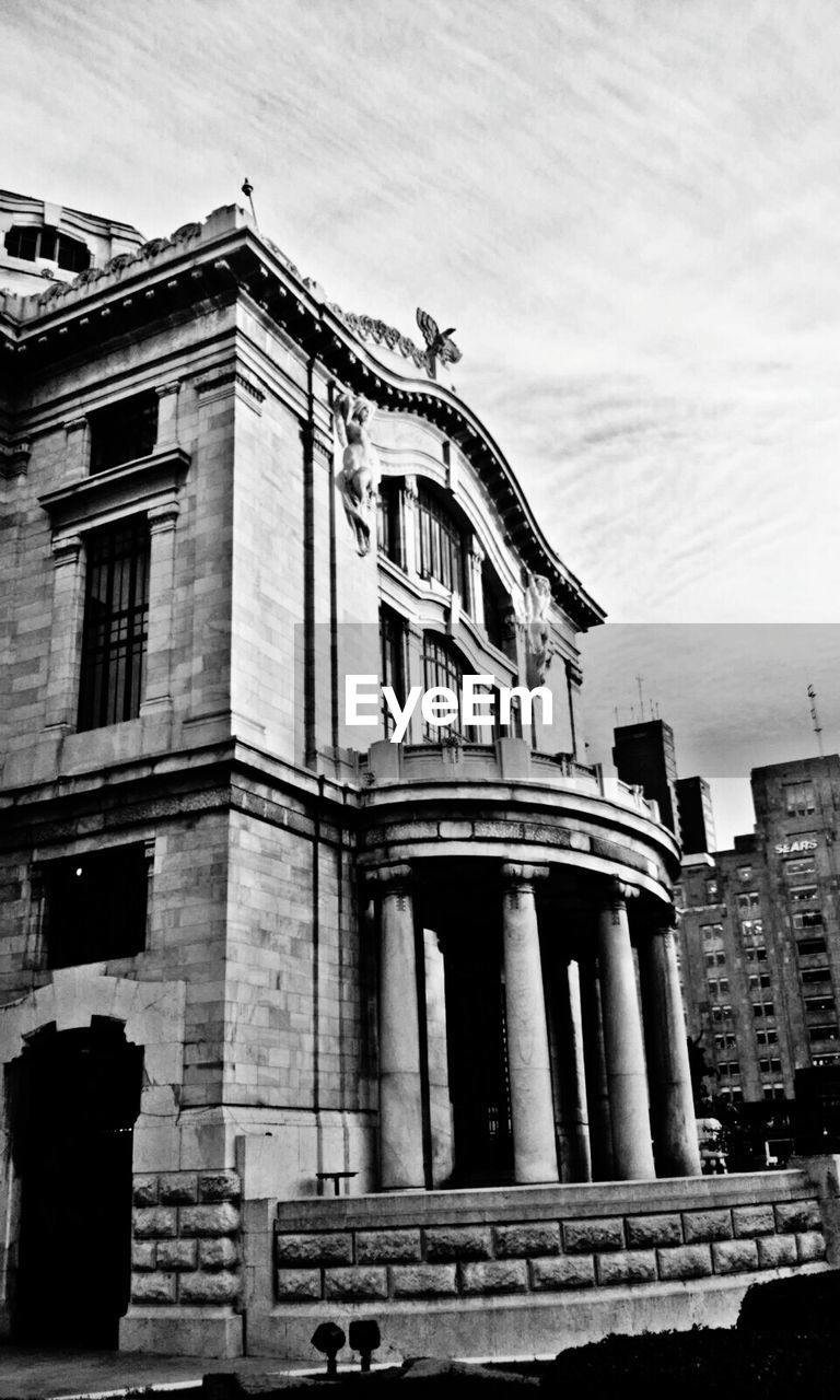 architecture, building exterior, built structure, history, outdoors, architectural column, sky, day, low angle view, no people