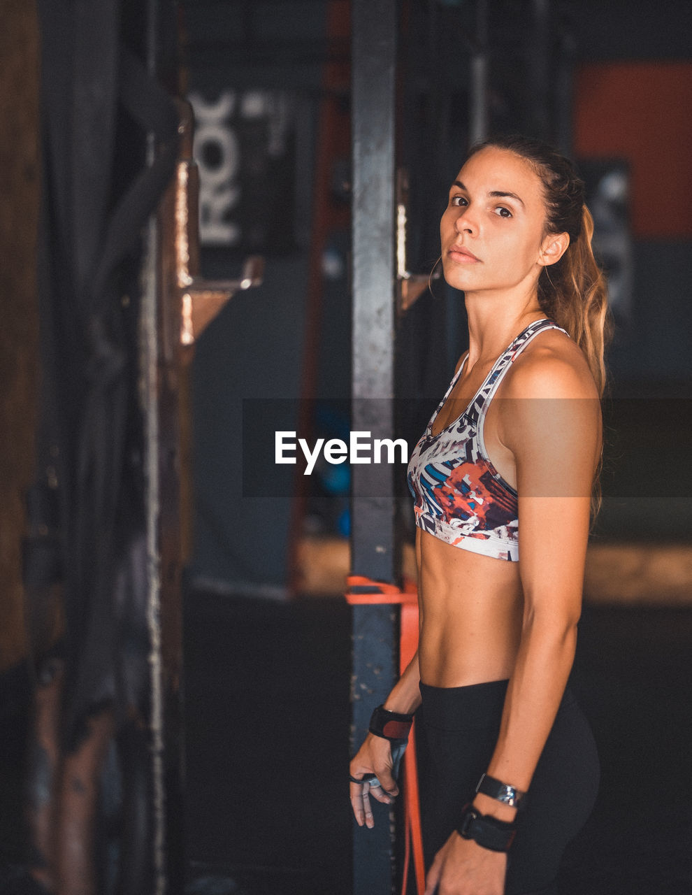 Portrait Of Young Woman Exercising In Gym