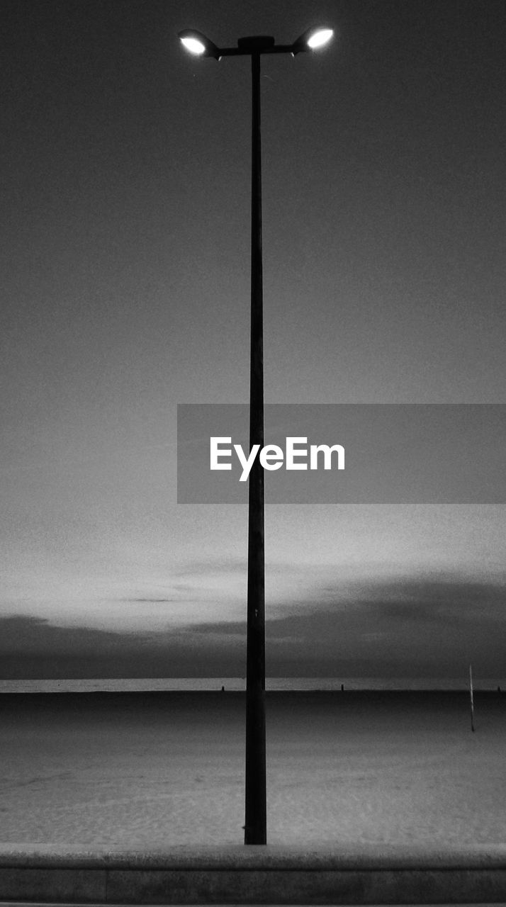 lighting equipment, illuminated, no people, sky, sea, outdoors, horizon over water, water, nature, day