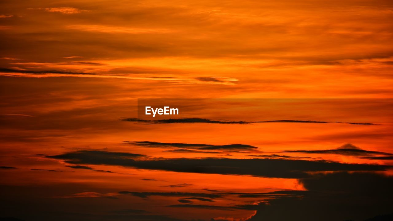sunset, orange color, dramatic sky, cloud - sky, beauty in nature, nature, sky, silhouette, backgrounds, scenics, no people, vibrant color, tranquil scene, tranquility, outdoors, red, sky only, day