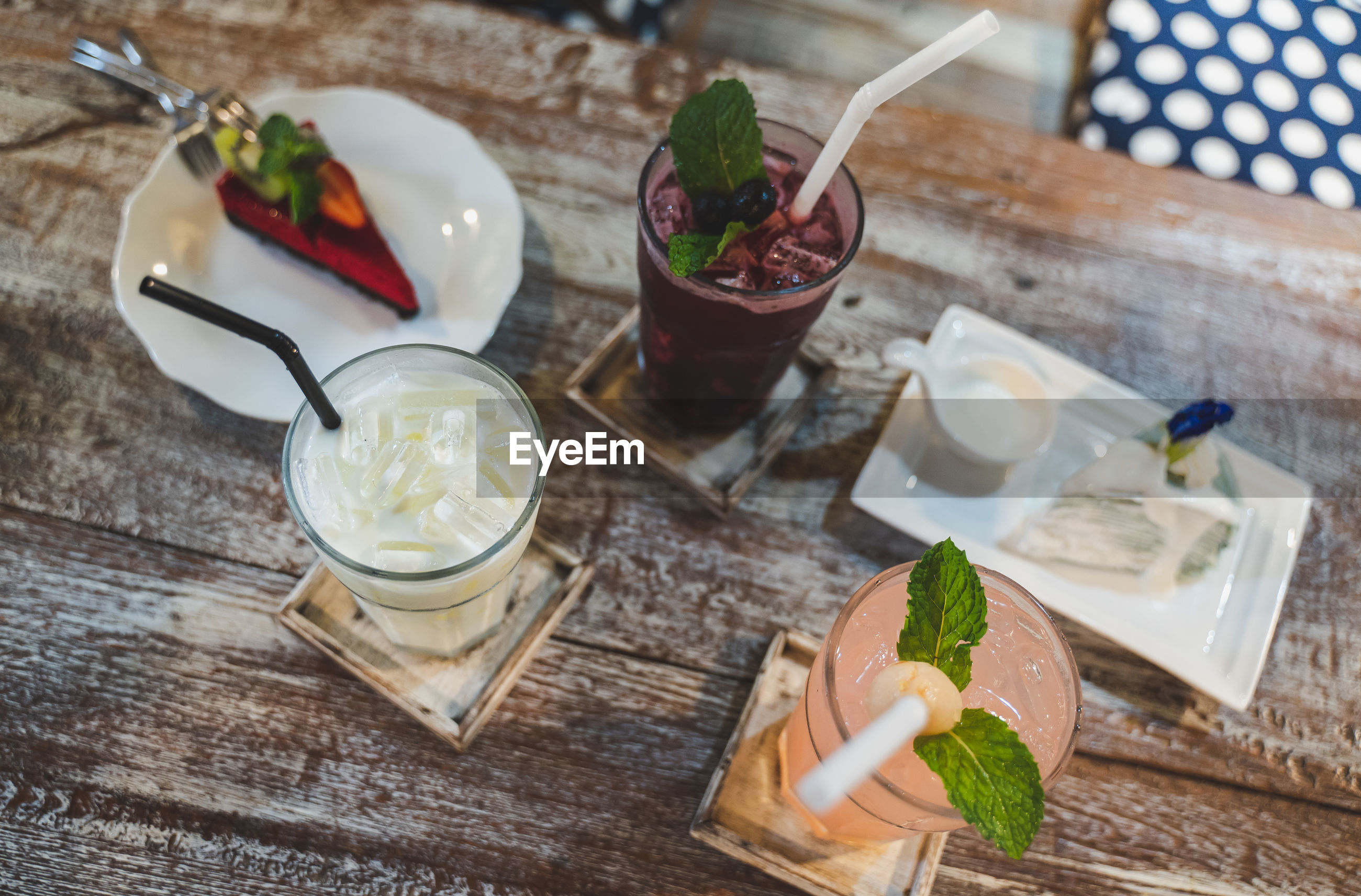 High angle view of dessert with drinks on wooden table