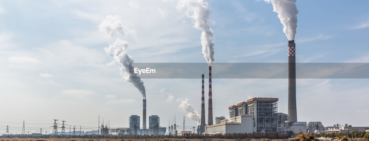 SMOKE EMITTING FROM INDUSTRY AGAINST SKY