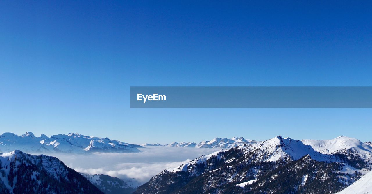 mountain, snow, sky, cold temperature, scenics - nature, winter, beauty in nature, mountain range, copy space, blue, clear sky, tranquil scene, tranquility, nature, snowcapped mountain, landscape, no people, non-urban scene, environment, mountain peak, outdoors