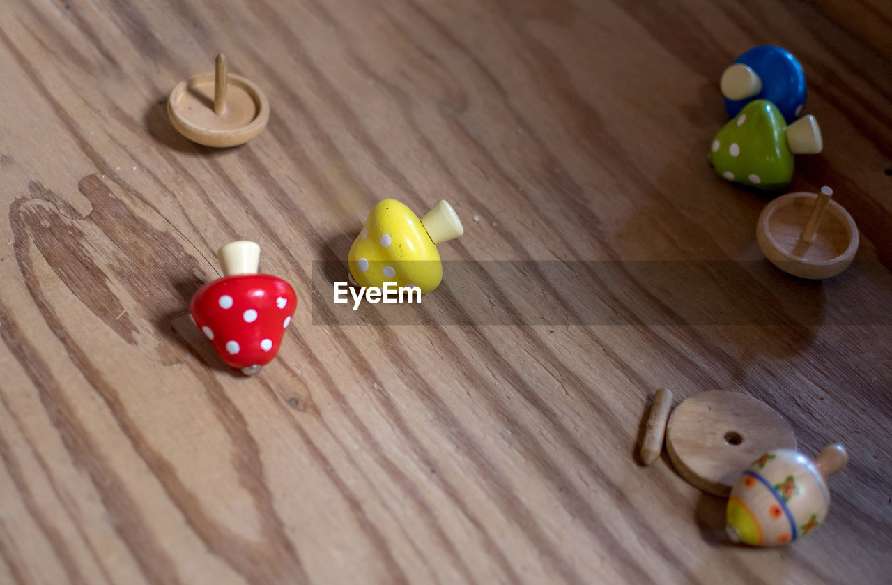 High angle view of wooden top  toys on table