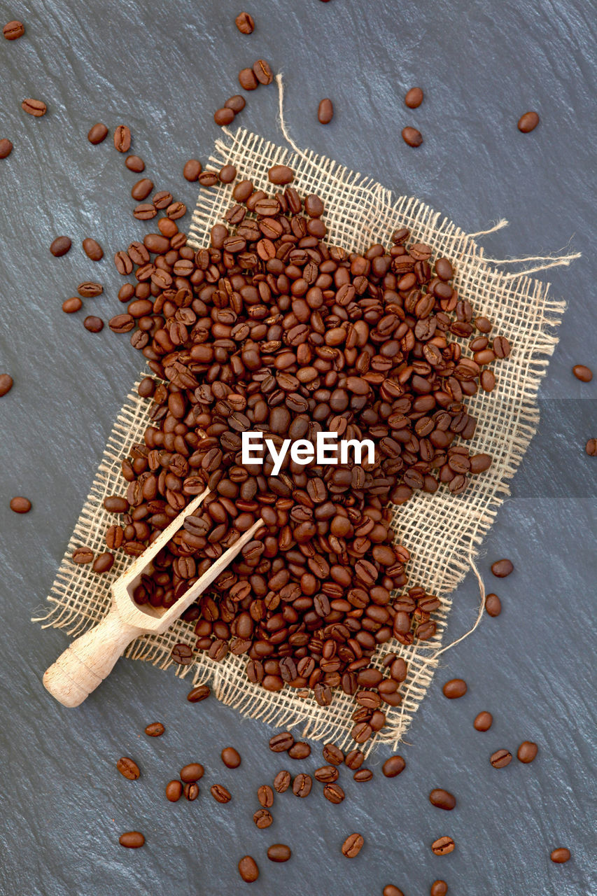 food and drink, food, large group of objects, freshness, high angle view, seed, table, no people, coffee, still life, indoors, directly above, roasted coffee bean, abundance, brown, coffee - drink, sack, healthy eating, close-up, wellbeing, caffeine