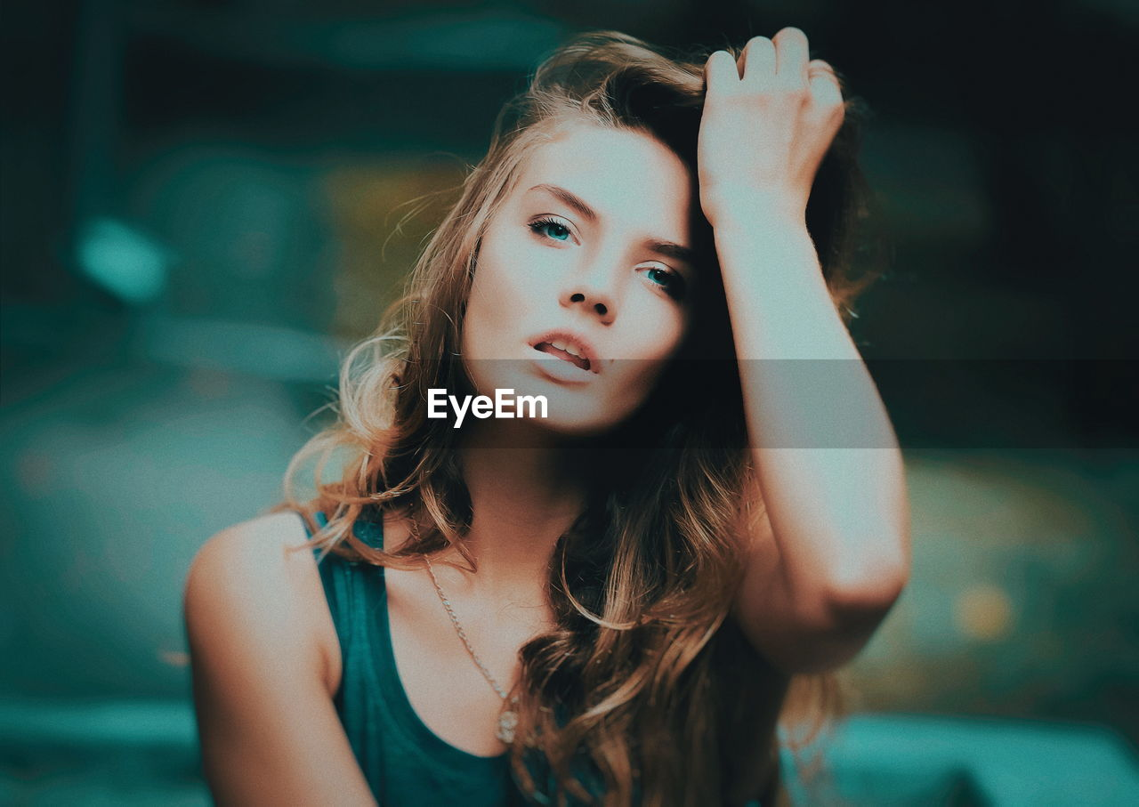 one person, focus on foreground, portrait, real people, front view, lifestyles, young women, headshot, young adult, hair, women, beauty, beautiful woman, long hair, leisure activity, looking at camera, hairstyle, looking, contemplation, teenager