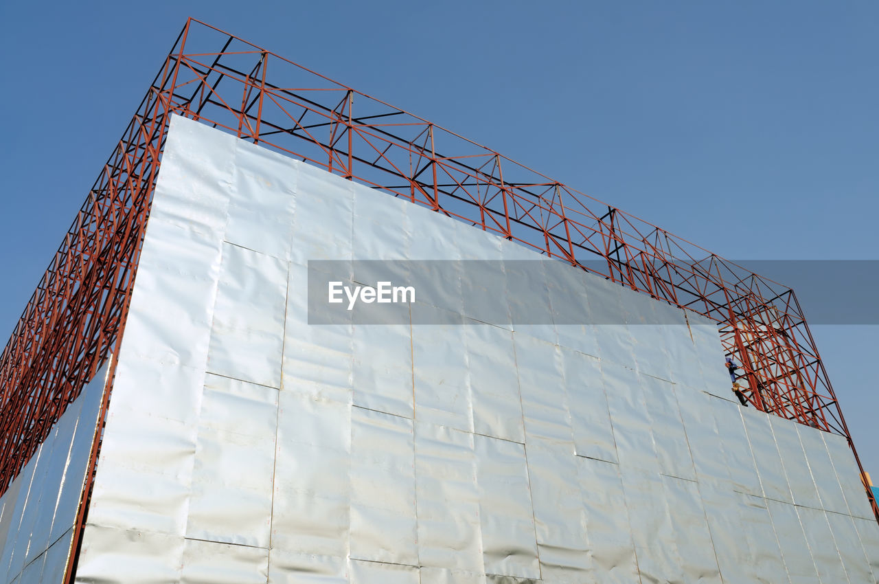 Low Angle View Of Built Structure At Construction Site Against Clear Blue Sky