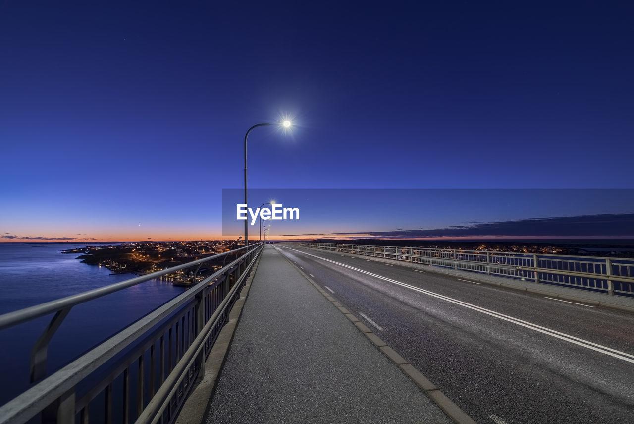 Street Lights On Bridge Against Sky In City