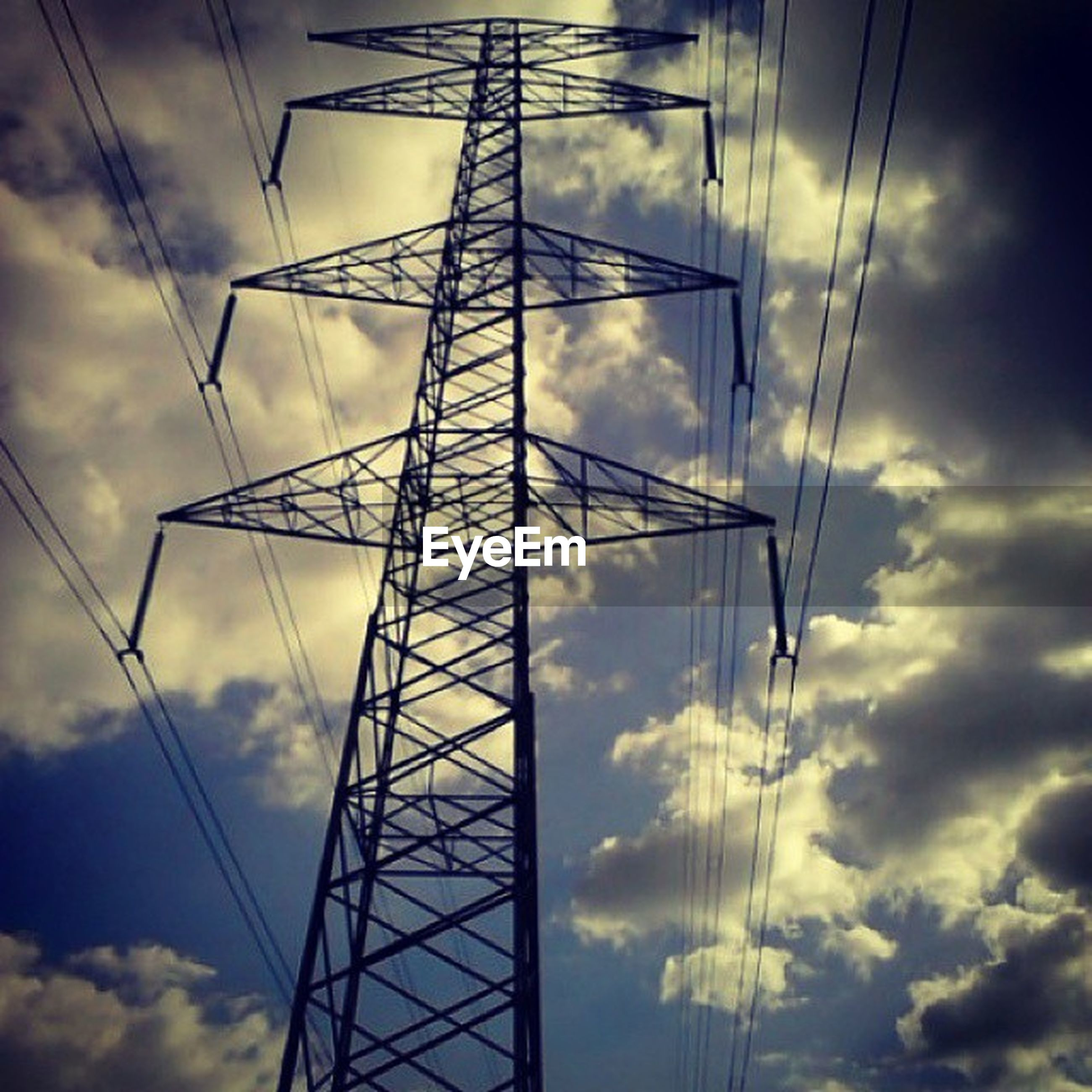 low angle view, power line, sky, electricity pylon, power supply, electricity, connection, cloud - sky, cable, cloudy, fuel and power generation, technology, cloud, silhouette, no people, outdoors, blue, nature, sunset, tall - high